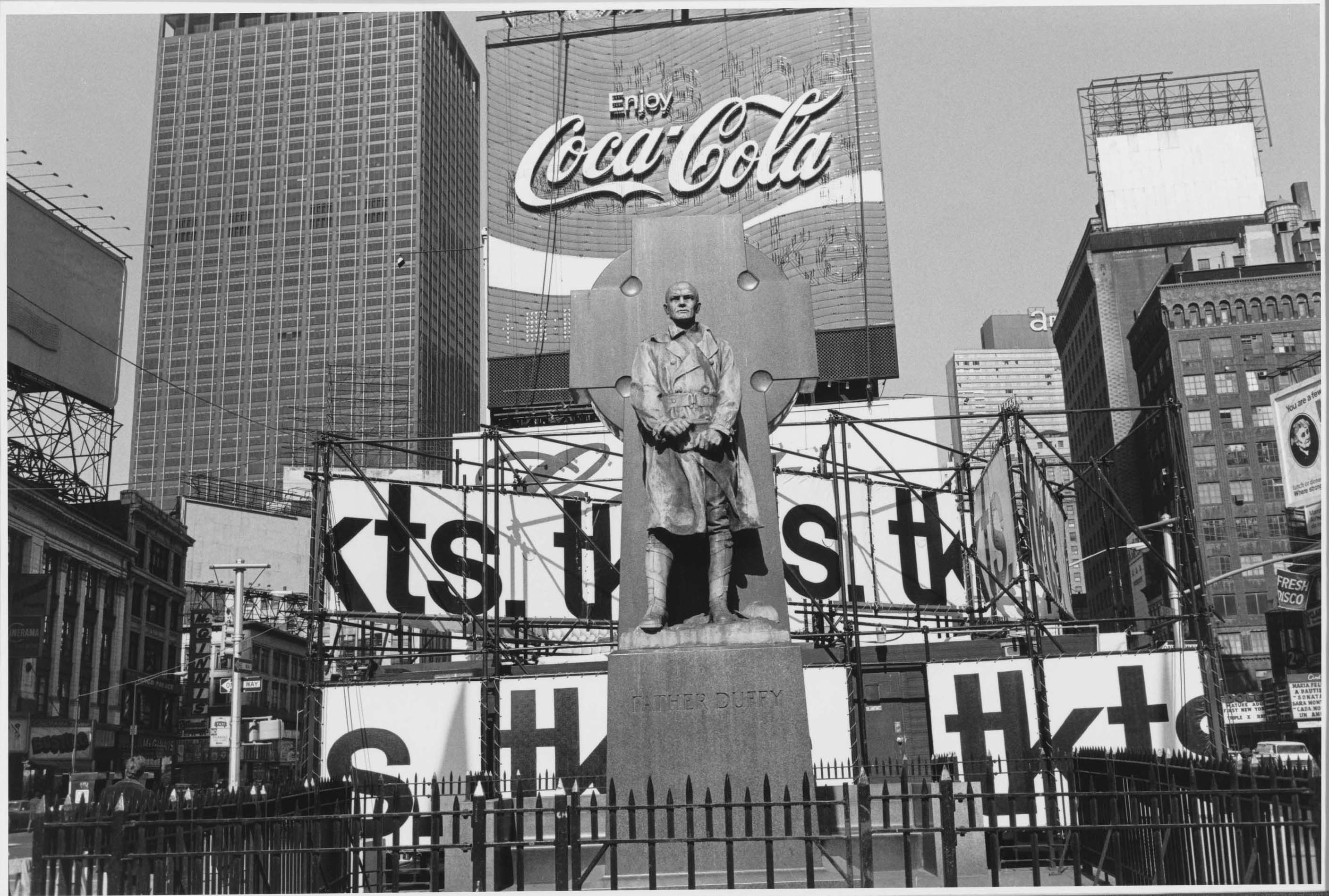 Lee Friedlander. Father Duffy. Times Square, New York City. 1974. Gelatin silver print, 71/2 × 11 1/4″ (19.1 × 28.5 cm). The Museum of Modern Art, New York. Purchase. © 2005 Lee Friedlander