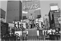 Lee Friedlander. *Father Duffy. Times Square, New York City.* 1974. Gelatin silver print, 71/2 × 11 1/4″ (19.1 × 28.5 cm). The Museum of Modern Art, New York. Purchase. © 2005 Lee Friedlander