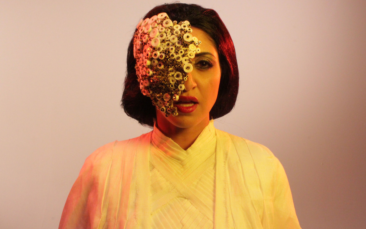 MASK played by Houda Echouafni, production still from *Piercing Brightness*. Directed by Shezad Dawood. 2013. Courtesy of UBIK Productions Ltd.  Photograph by Richard Harrowing