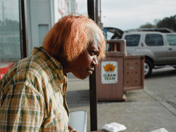 Paul Graham. *New Orleans (Woman Eating).* 2004. One of six pigmented inkjet prints, 24 × 32″ (61 × 81.3 cm). Acquired through the generosity of the Photography Council Fund and The Contemporary Arts Council of The Museum of Modern Art. © 2009 Paul Graham