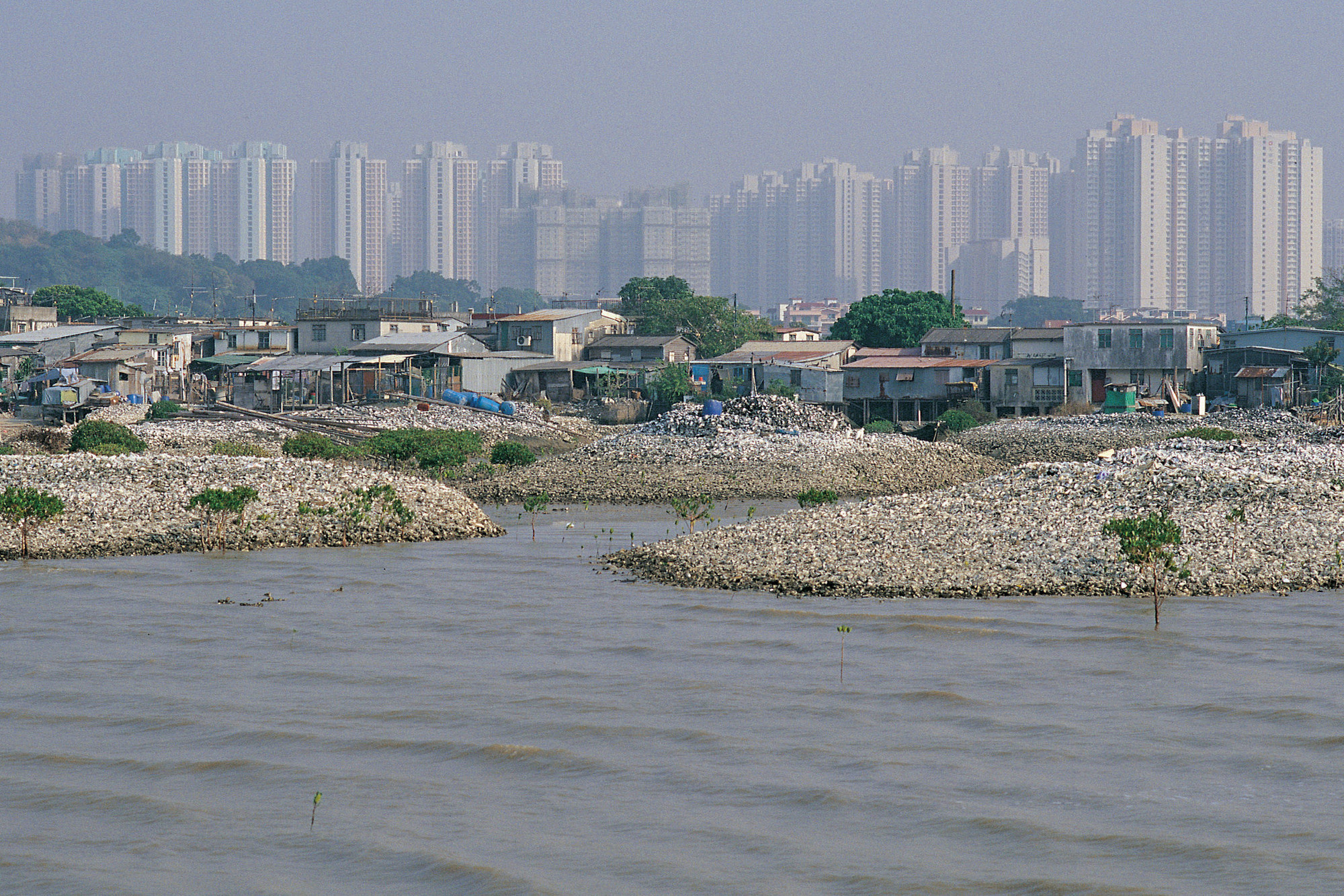 MAP Office Lau Fan Shan oyster farm in the shadows of Tin Shui Wai New Town, Hong Kong. 2014. © Map Office