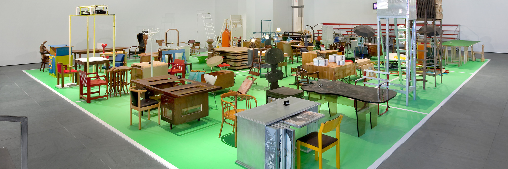 "Martin Kippenberger. Installation view of The Happy End of Franz Kafka's ""Amerika."" Mixed media, dimensions variable. © Estate Martin Kippenberger, Galerie Gisela Capitain, Cologne. Photo © 2009 Jason Mandella"