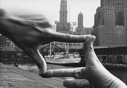 "John Baldessari (American, b. 1931). Hands Framing New York Harbor from Pier 18. 1971. Photograph by Shunk-Kender (Harry Shunk [German, 1924–2006] and János Kender [Hungarian, 1937–2009]). Gelatin silver print, 7 3/8 × 9 15/16"" (18.8 × 25.2 cm). The Museum of Modern Art, New York. Gift of the Roy Lichtenstein Foundation in honor of Jennifer Winkworth and Kynaston McShine and in memory of Harry Shunk and János Kender. © 2015 John Baldessari. Photograph: Shunk-Kender © J. Paul Getty Trust. The Getty Research Institute, Los Angeles"