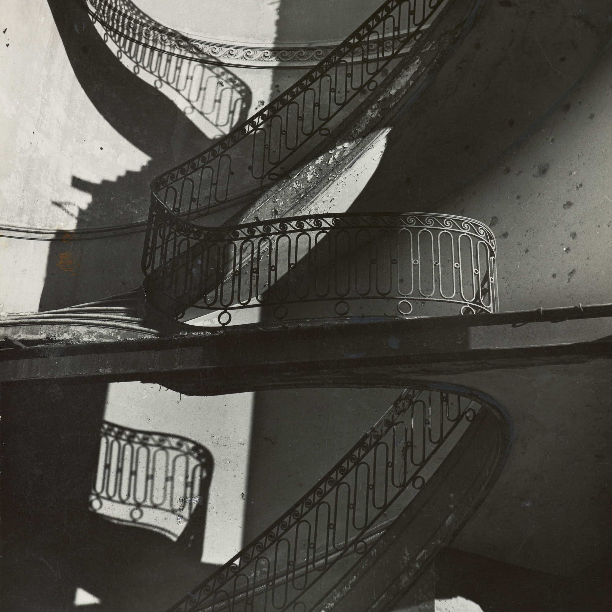 "Bill Brandt. Bombed Regency Staircase, Upper Brook Street, Mayfair. c. 1942. Gelatin silver print, 9 x 7 5/8"" (22.8 x 19.4 cm). Acquired through the generosity of Clarissa A. Bronfman"
