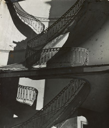 Bill Brandt. *Bombed Regency Staircase, Upper Brook Street, Mayfair.* c. 1942. Gelatin silver print, 9 × 7 5/8″ (22.8 × 19.4 cm). Acquired through the generosity of Clarissa A. Bronfman