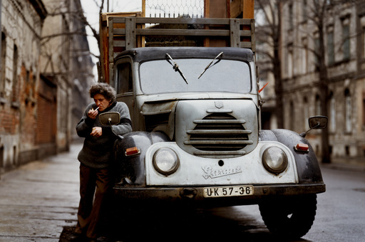 Eberhard Grames (German, b. 1953). Man with His Truck, East Germany. 1990. Chromogenic color print, 15 3/4 × 19 3/4ʺ (40 × 50.2 cm). Horace W. Goldsmith Fund through Robert B. Menschel. © 2016 Ebergard Grames