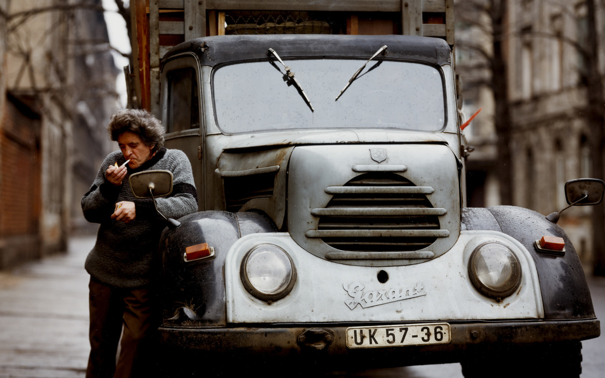 Eberhard Grames (German, b. 1953). *Man with His Truck, East Germany.* 1990. Chromogenic color print, 15 3/4 × 19 3/4ʺ (40 × 50.2 cm). Horace W. Goldsmith Fund through Robert B. Menschel. © 2016 Ebergard Grames
