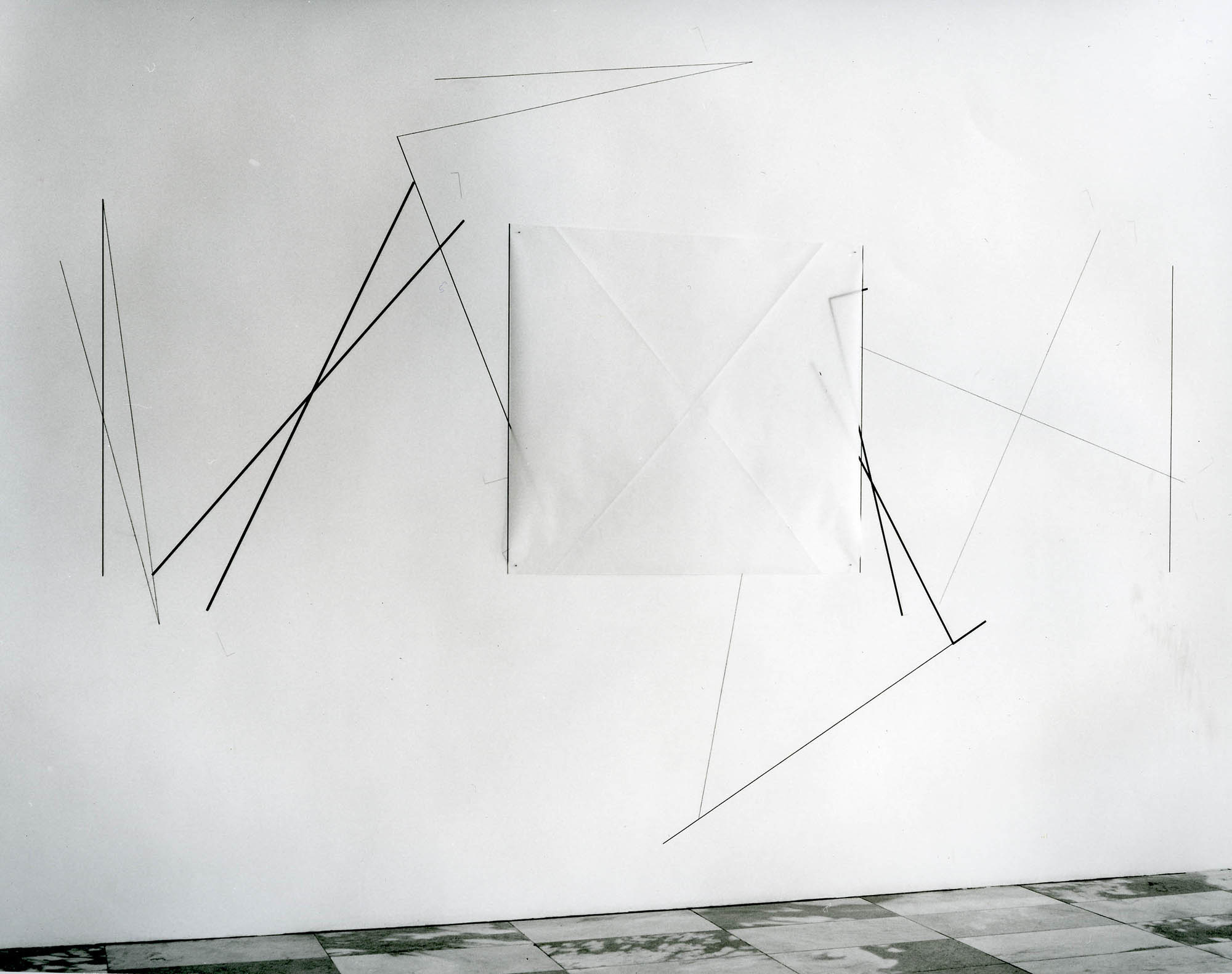 Installation view, Dorothea Rockburne: Drawing Which Makes Itself, Museum of Modern Art. Clockwise from left, on the walls and floor: Drawing Which Makes Itself: Hartford Installation, 1973, Nesting, 1972, Neighbourhood, 1973, Arc, 1973, Diamond–Paralellogram Overlapping, 1973. Digital Image © 2013 The Museum of Modern Art, New York.