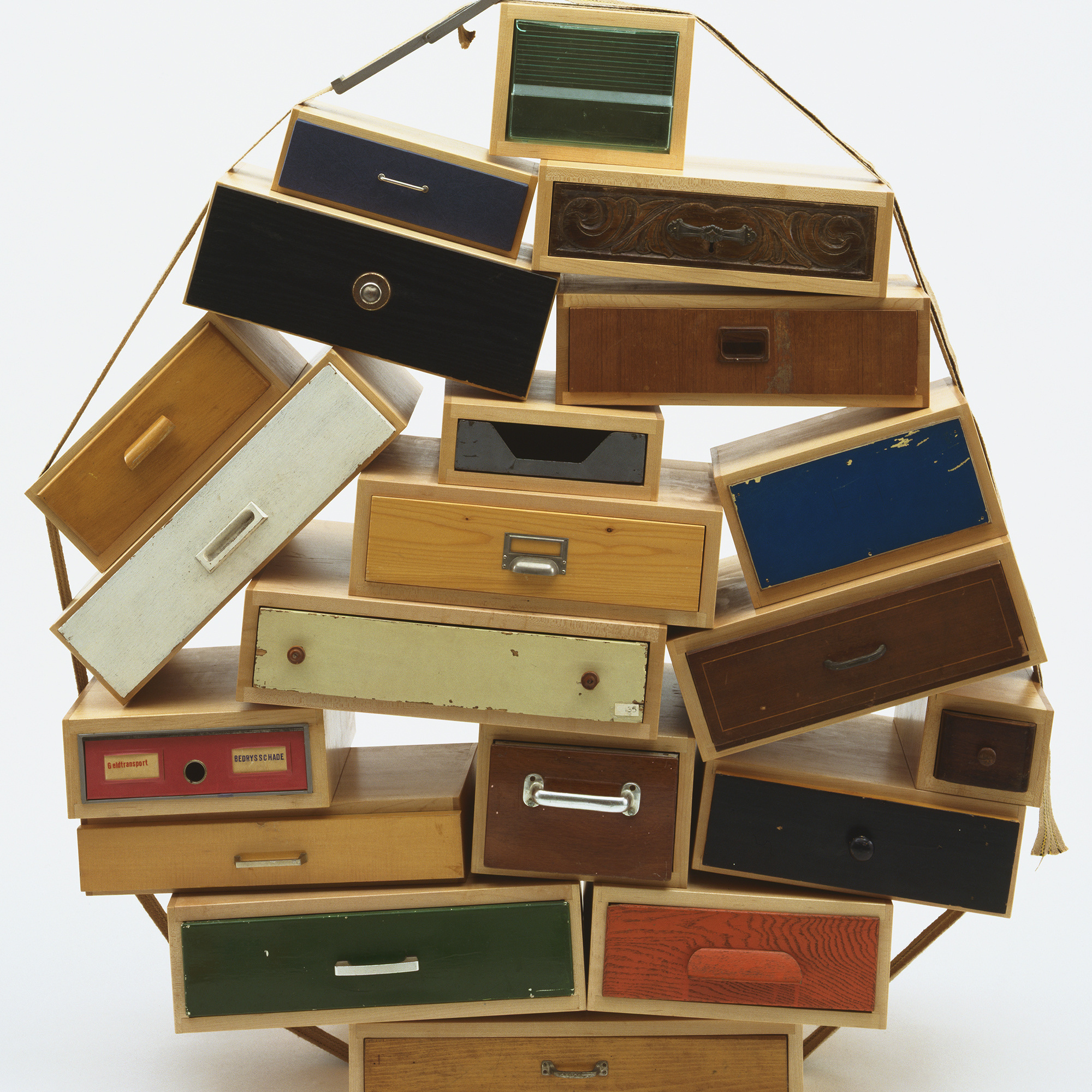Tejo Remy. You Can't Lay Down Your Memory Chest of Drawers. 1991. Metal, paper, plastic, burlap, contact paper and paint, 55.5 × 53 × 20″ (141 × 134.6 × 50.8 cm). Manufactured by Tejo Remy for Droog Design, the Netherlands. Frederieke Taylor Purchase Fund