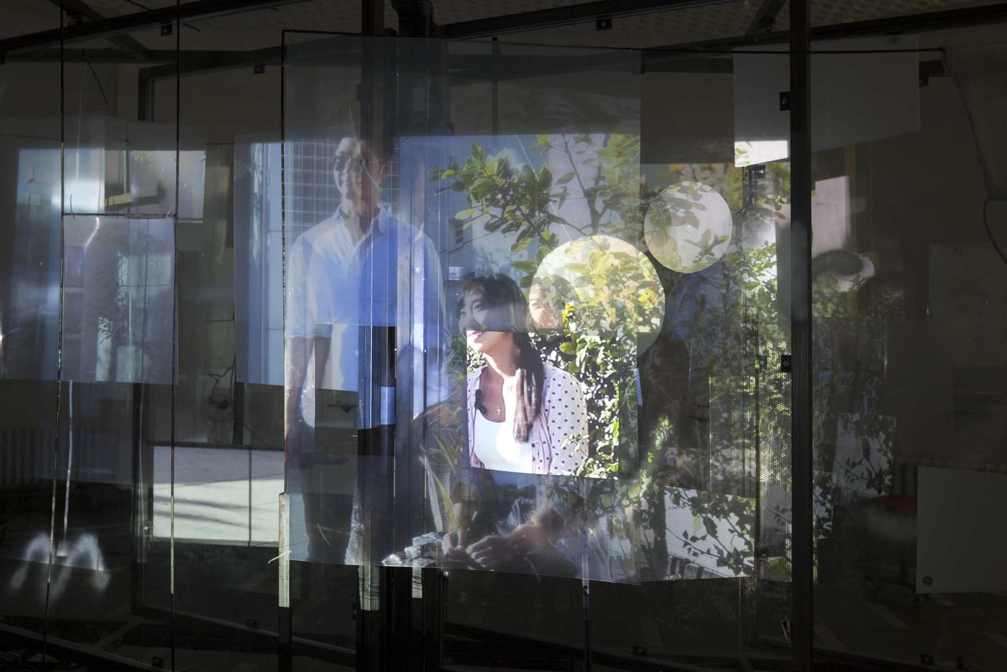 Neïl Beloufa. Superlatives and Resolution, People's Passion, Movement and Life. 2014. Video (color, sound, 10:59 min), plexiglass, steel construction, digitally controlled motor, computer prints on paper, tape, plastic sheets, MDF, and clay, dimensions variable. Installation view, Hopes for the Best, Schinkel Pavilion, Berlin, April 4–May 31, 2015. Collection of K11Art Foundation, Hong Kong. Courtesy the artist; François Ghebaly Gallery, Los Angeles; Mendes Wood DM, São Paulo; and ZERO…, Milan. Photo: Andreas Rossetti