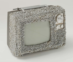 Nam June Paik and Otto Piene. *Untitled.* 1968. Manipulated television set and plastic pearls, 9 × 13 × 10″ (22.9 × 33 × 25.4 cm). Gift of The Junior Associates of The Museum of Modern Art, New York, The Greenwich Collection Ltd. Fund, and gift of Margot Ernst. © 2003 The Museum of Modern Art. Photo: Thomas Griesel