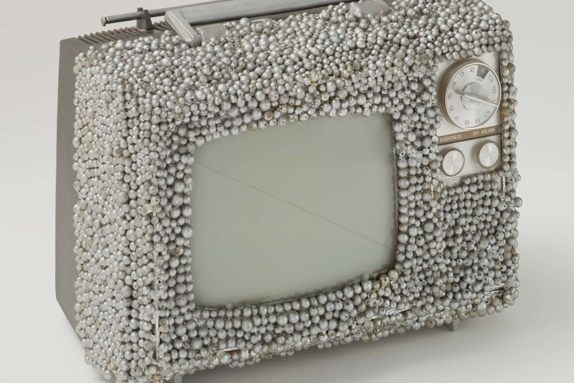 Nam June Paik and Otto Piene. Untitled. 1968. Manipulated television set and plastic pearls, 9 × 13 × 10″ (22.9 × 33 × 25.4 cm). Gift of The Junior Associates of The Museum of Modern Art, New York, The Greenwich Collection Ltd. Fund, and gift of Margot Ernst. © 2003 The Museum of Modern Art. Photo: Thomas Griesel