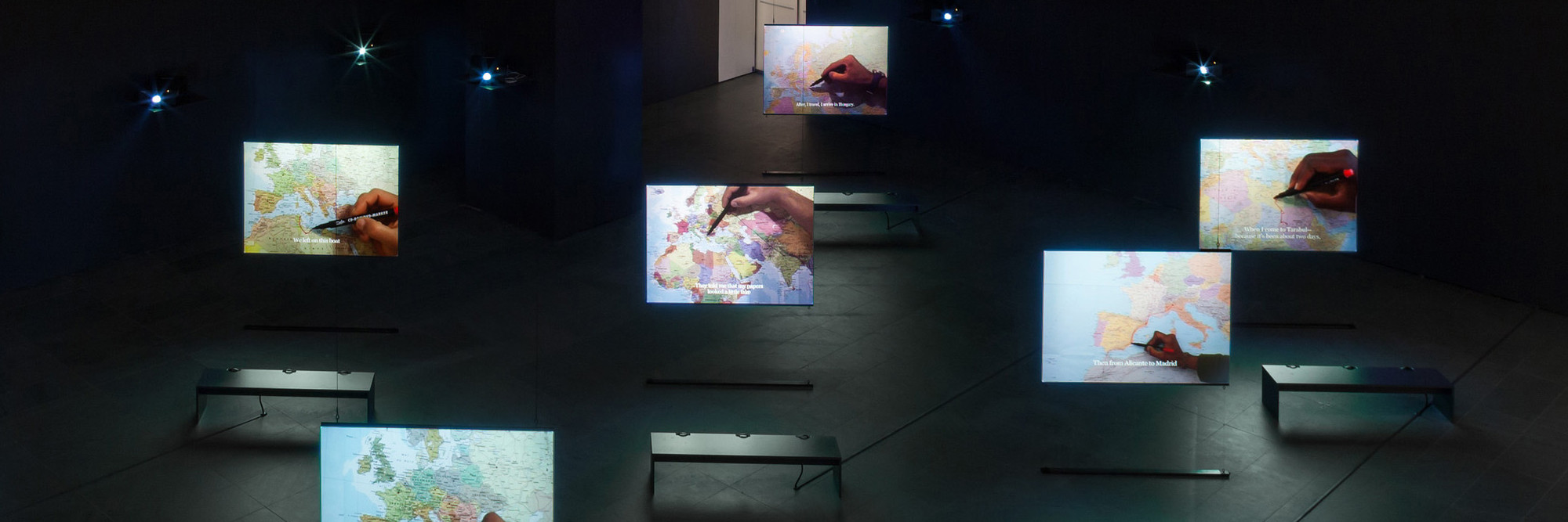 Bouchra Khalili. The Mapping Journey Project. 2008–11. Eight-channel video (color, sound). Installation view, Bouchra Khalili: The Mapping Journey Project, The Museum of Modern Art, New York, April 9–August 28, 2016. The Museum of Modern Art, New York. Fund for the Twenty First Century, 2014. © 2016 Bouchra Khalili. Digital image © 2016 The Museum of Modern Art. Photo: Jonathan Muzikar