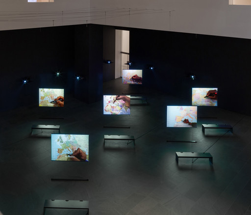 Bouchra Khalili. *The Mapping Journey Project.* 2008–11. Eight-channel video (color, sound). Installation view, *Bouchra Khalili: The Mapping Journey Project*, The Museum of Modern Art, New York, April 9–August 28, 2016. The Museum of Modern Art, New York. Fund for the Twenty First Century, 2014. © 2016 Bouchra Khalili. Digital image © 2016 The Museum of Modern Art. Photo: Jonathan Muzikar