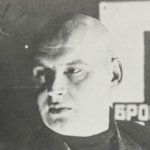 "Aleksandr Rodchenko. Untitled (Self-portrait with poster for Battleship Potemkin). c. 1925. Gelatin silver print, Sheet: 3 3/4 x 4 9/16"" (9.6 x 11.6 cm). Gift of The Judith Rothschild Foundation"