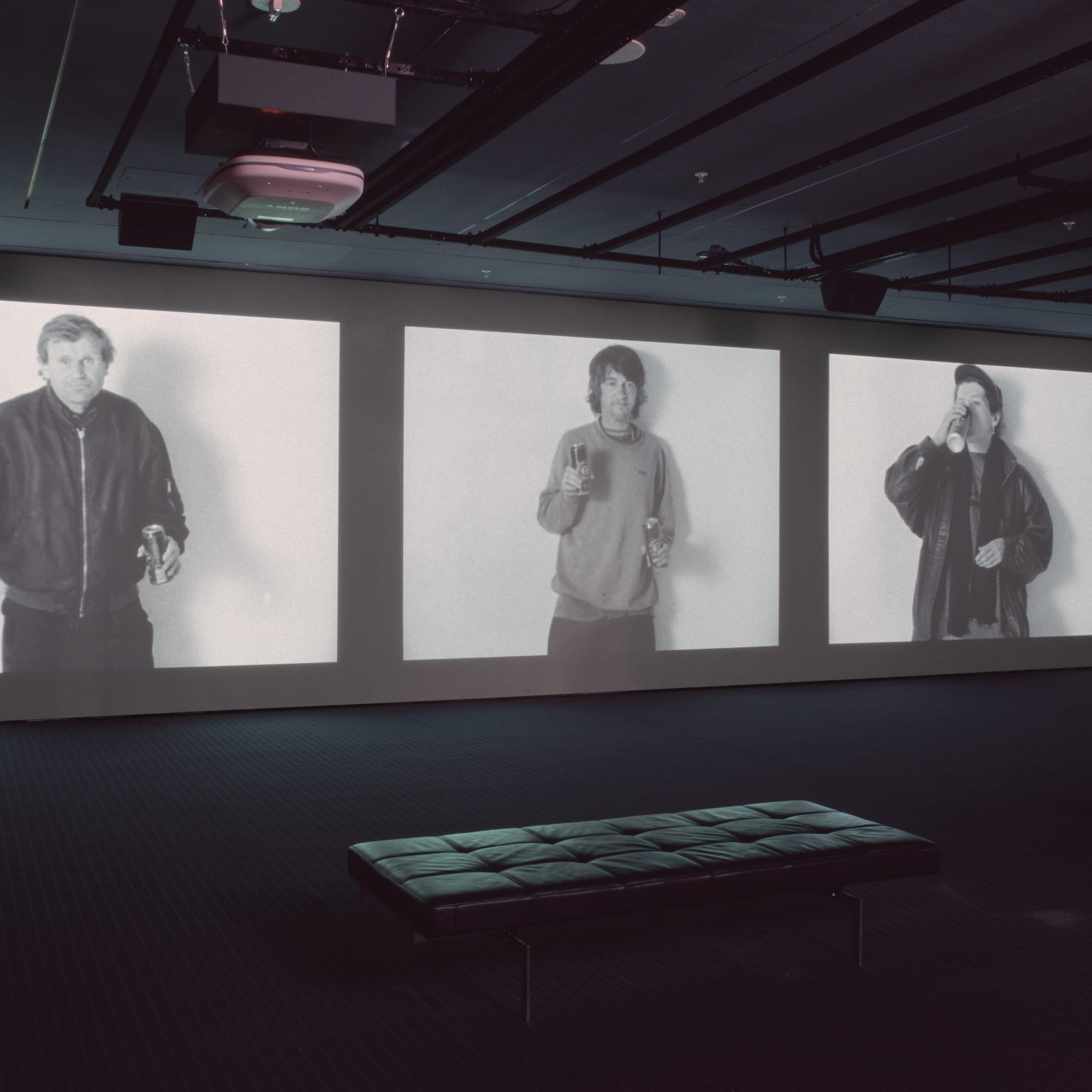Gillian Wearing. Drunk. 1997–1999. Three-channel video (black and white, sound), 28:35 min. Dimensions variable; approximately 13′ × 37′ × 22' (396.2 × 1127.8 × 670.6 cm). Gift of Nina and Gordon Bunshaft, The Ken and Judith Joy Family Foundation, Barbara Foshay, and Margot P. Ernst. © 2016 Gillian Wearing