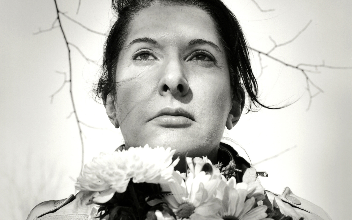 Marina Abramović. *Portrait with Flowers.* 2009. Black-and-white gelatin silver print; photo: Marco Anelli. © 2010 Marina Abramović. Courtesy the artist and Sean Kelly Gallery/Artists Rights Society (ARS), New York