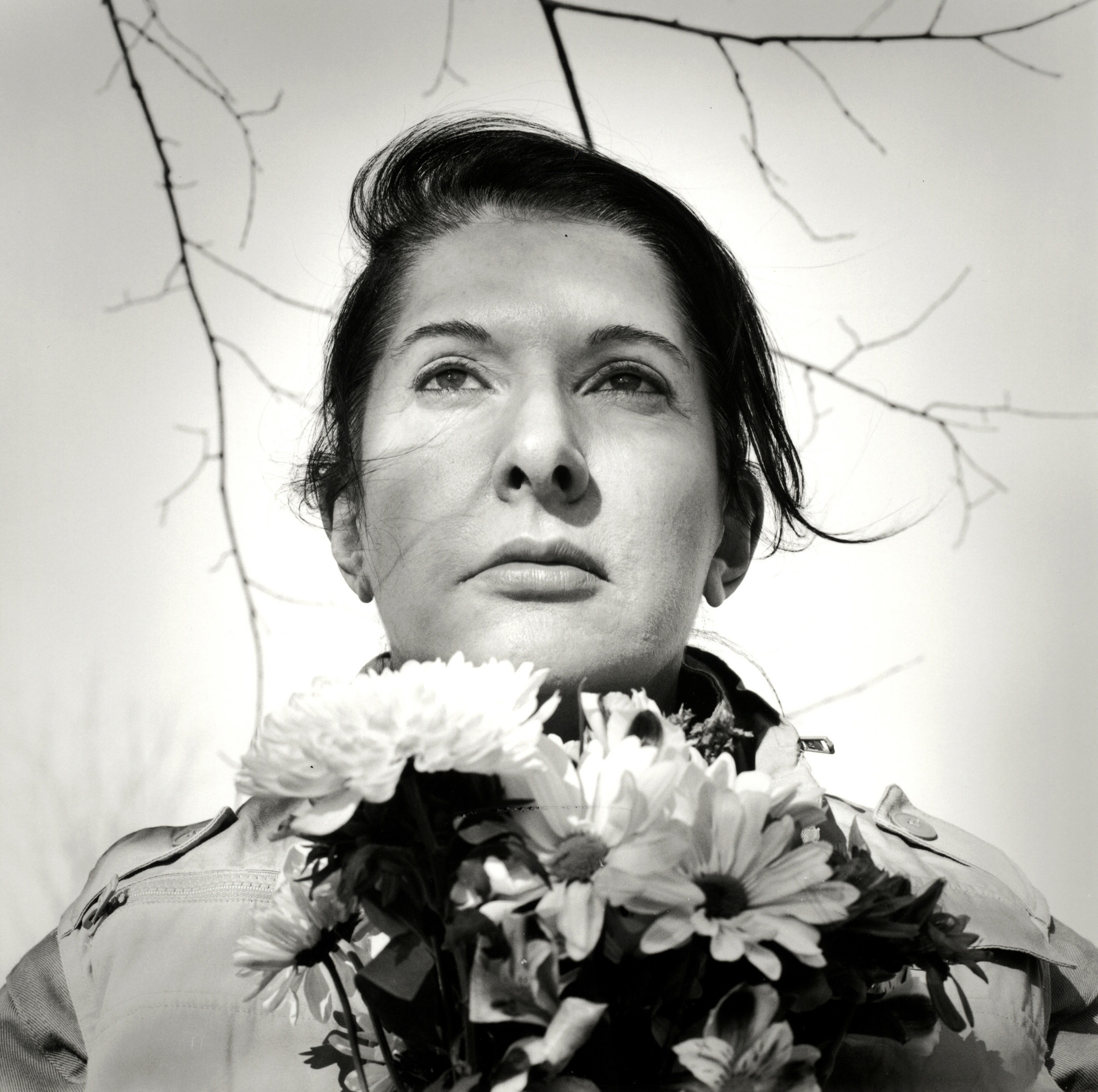 Marina abramovi the artist is present moma marina abramovi portrait with flowers 2009 black and white gelatin silver thecheapjerseys Image collections