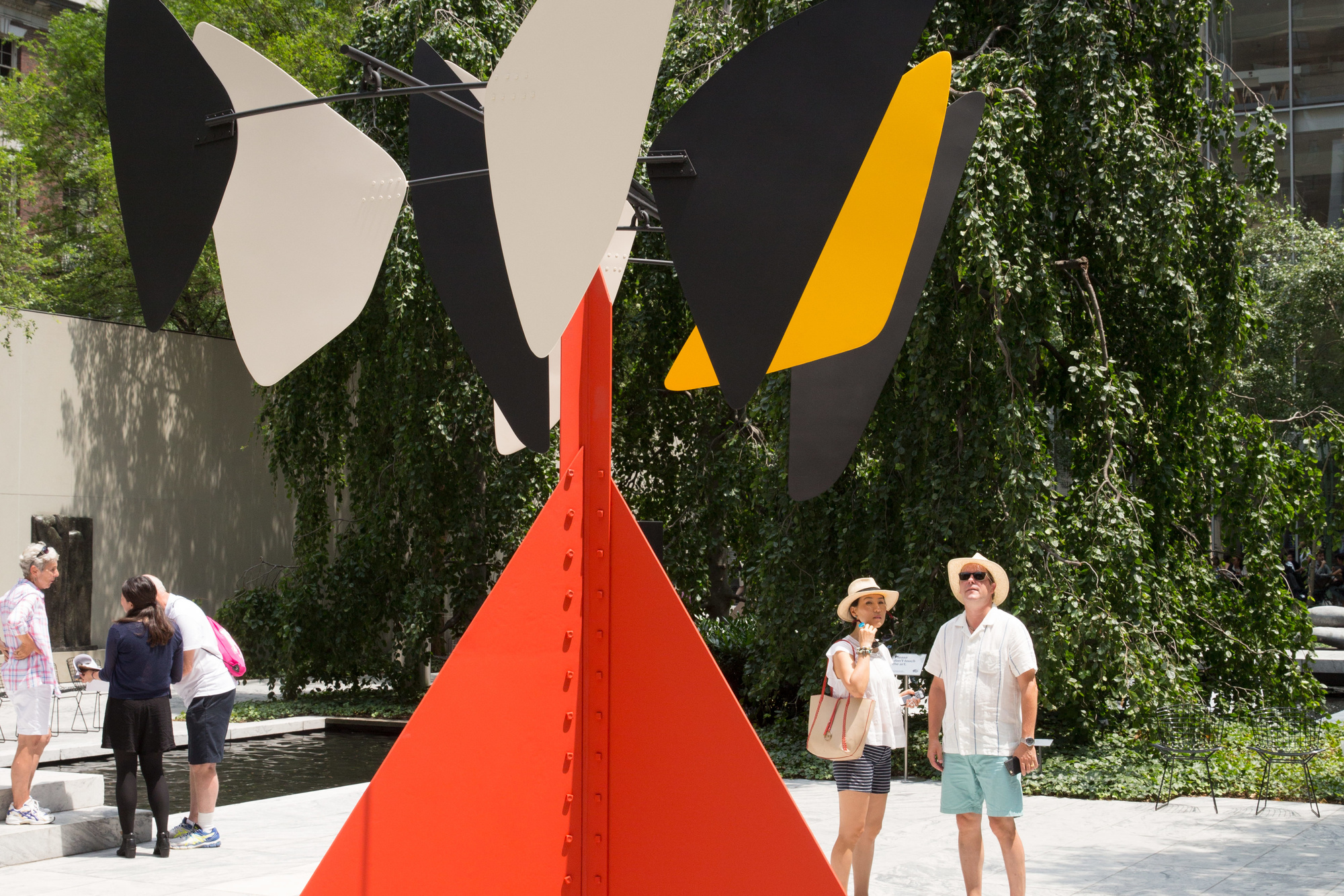 Image of The Abby Aldrich Rockefeller Sculpture Garden at The Museum of Modern Art. Pictured: Alexander Calder. Sandy's Butterfly. 1964. Painted sheet steel and iron rods. Gift of the artist. © 2016 Calder Foundation, New York/Artists Rights Society (ARS), New York. Photos: Gus Powell