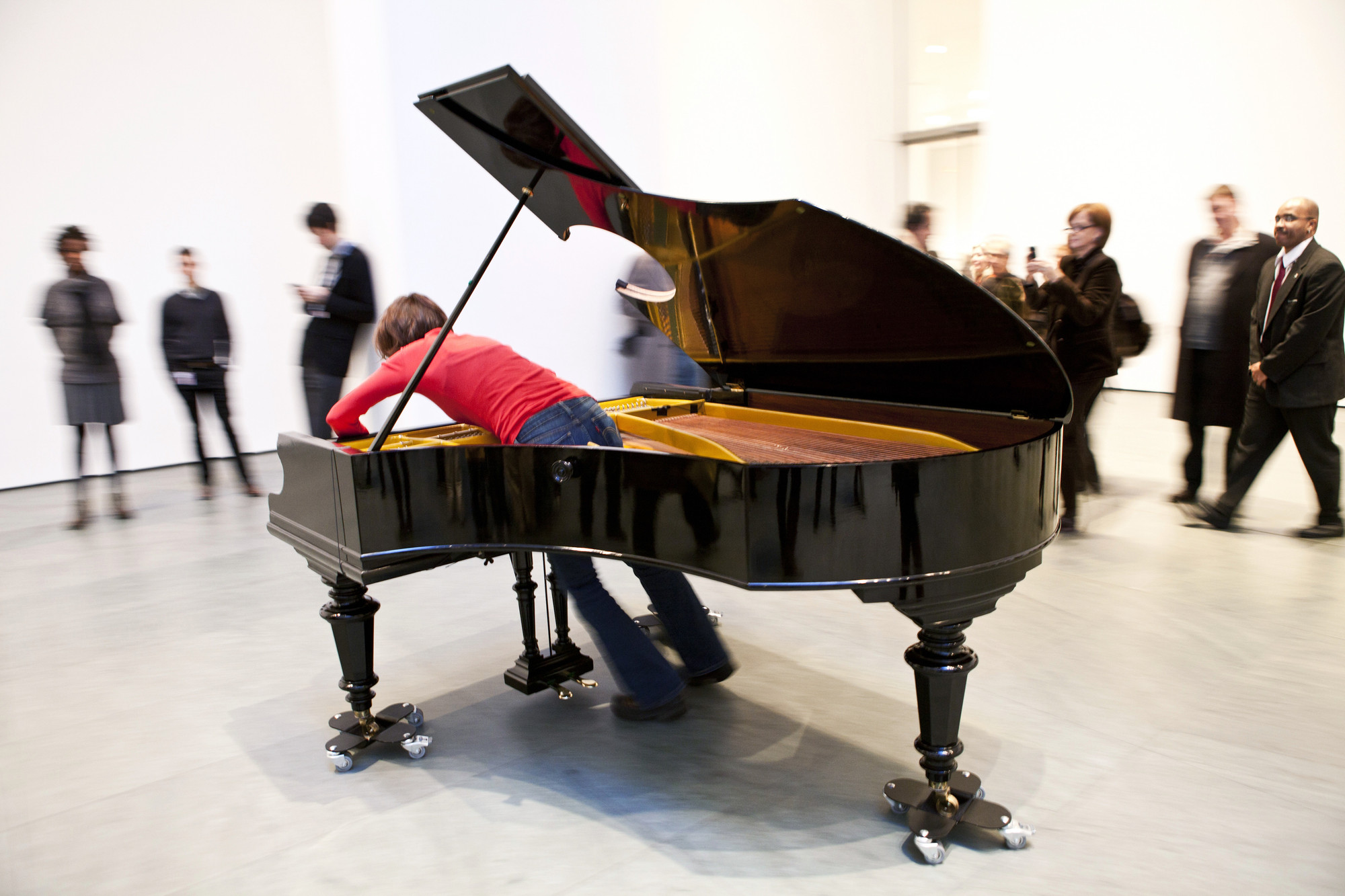 "Jennifer Allora and Guillermo Calzadilla. Stop, Repair, Prepare: Variations on ""Ode to Joy"" for a Prepared Piano. 2008. Prepared Bechstein piano, pianist (Terezija Cukrov shown). Piano: 40 x 67 x 84"" (101.6 x 170.2 x 213.4 cm). The Museum of Modern Art. Gift of the Julia Stoschek Foundation, Düsseldorf. © 2011 Yi-Chun Wu/The Museum of Modern Art"