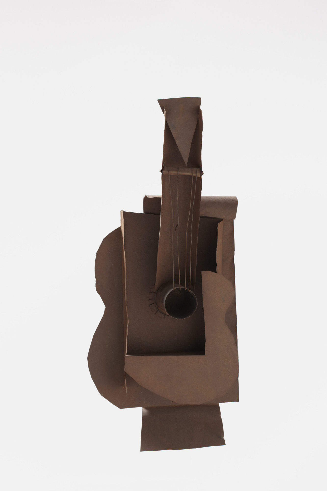 Pablo Picasso. Guitar. Paris, January–February 1914. Ferrous sheet metal and wire, 30 1/2 × 13 3/4 × 7 5/8″ (77.5 × 35 × 19.3 cm). Gift of the artist. © 2016 Estate of Pablo Picasso / Artists Rights Society (ARS), New York. Photo: Jonathan Muzikar