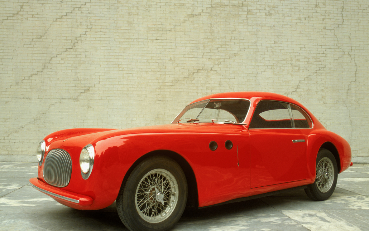 "Pininfarina (Battista ""Pinin"" Farina). Cisitalia 202 GT. 1946. Aluminum body, 49″ × 13′ 2″ × 57 7/8″ (125 × 401 × 147 cm). The Museum of Modern Art, New York. Gift of the manufacturer"