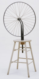 Marcel Duchamp. Bicycle Wheel. New York, 1951 (third version, after lost original of 1913). Metal wheel mounted on painted wood stool, 51 × 25 × 16 1/2ʺ (129.5 × 63.5 × 41.9 cm). The Sidney and Harriet Janis Collection. © 2016 Artists Rights Society (ARS), New York / ADAGP, Paris / Estate of Marcel Duchamp