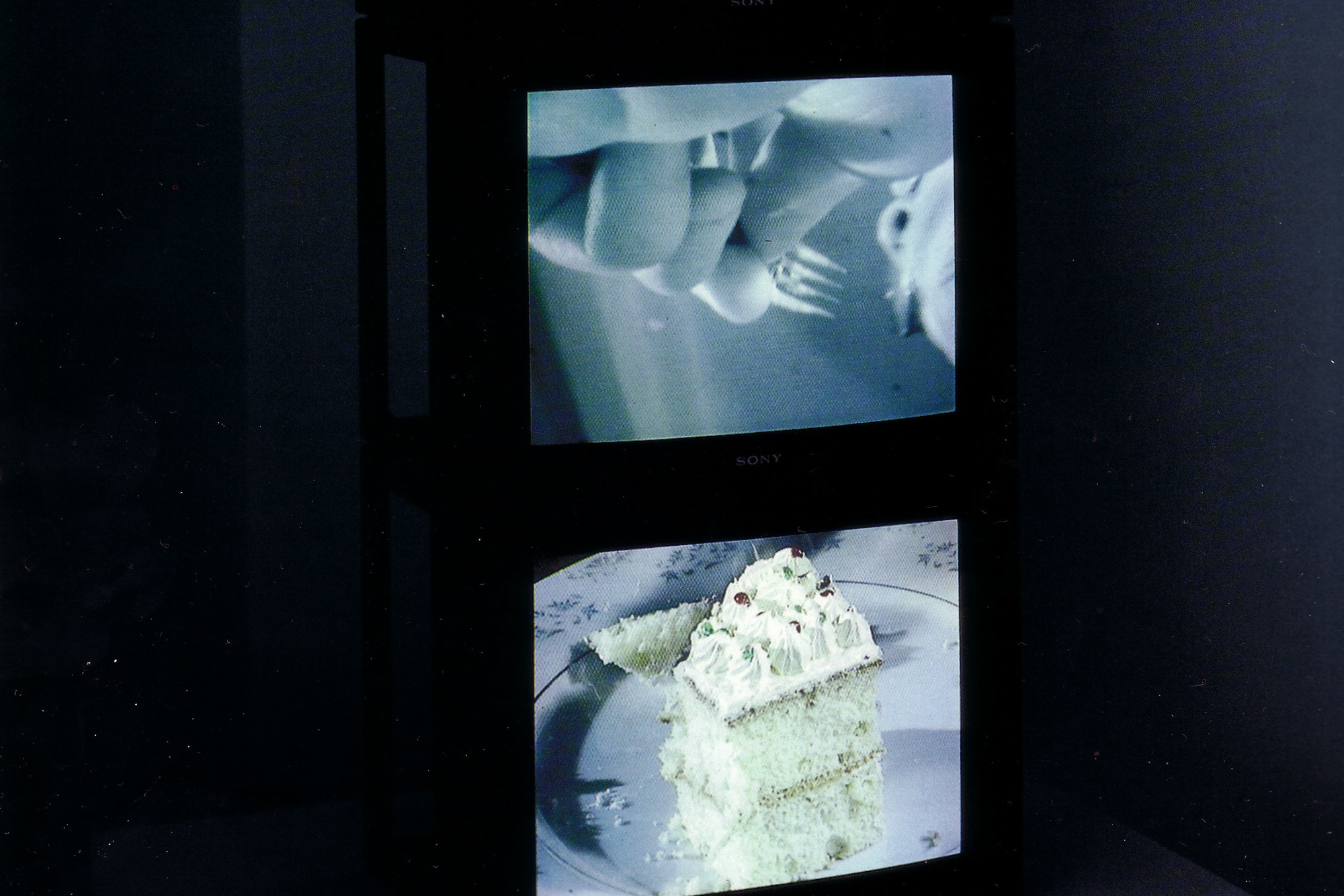 Zhang Peili. Eating. 1997. Three-channel video (color, sound). Gift of The Junior Associates of the Museum of Modern Art. © 2016 Zhang Peili
