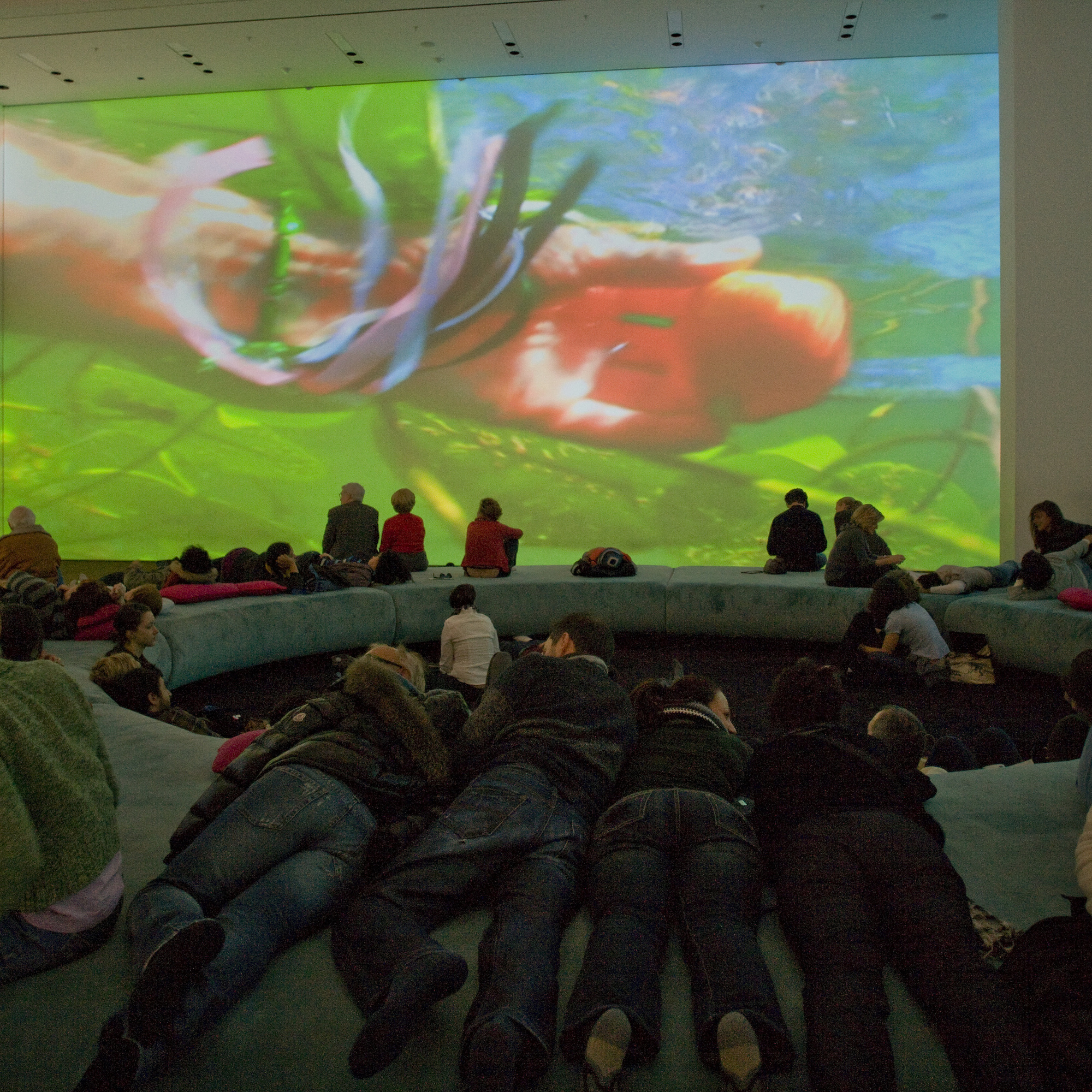 Pipilotti Rist. Pour Your Body Out (7354 Cubic Meters). 2008. Multichannel video projection (color, sound), projector enclosures, circular seating element, carpet. Installation view at The Museum of Modern Art, 2008. Photo: Thomas Griesel