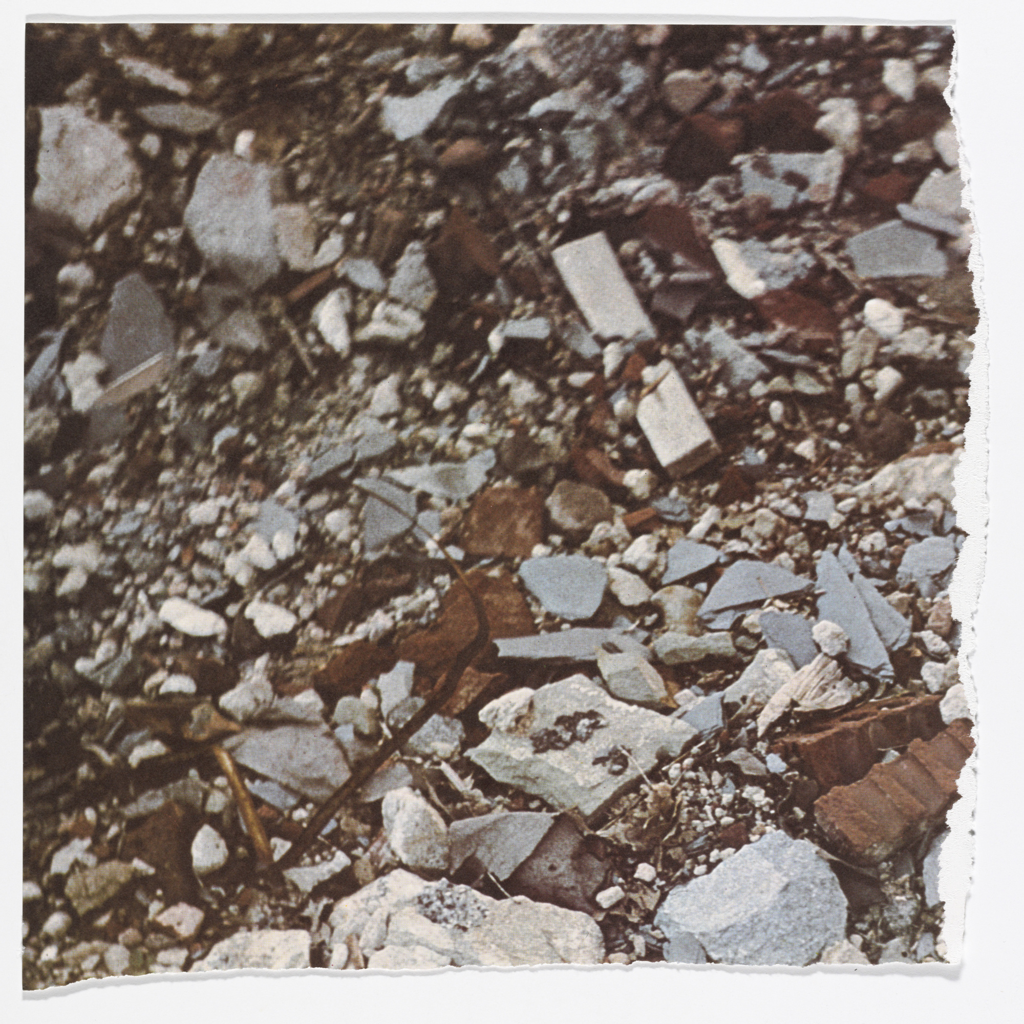 Robert Smithson. Torn Photograph from the 2nd Stop (Rubble) (2nd Mountain of Six Stops on a Section) from Artists & Photographs. 1970. Offset lithograph, torn into four pieces from a portfolio of nineteen printed objects (including box cover), ea. approx. sheet 10 7/8 × 11″ (27.6 × 28 cm). Gift of Kynaston McShine