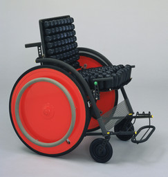 Kazuo Kawasaki. Carna Folding Wheelchair. 1989. Manufacturer: SIG Workshop Co. Ltd., Ishikawa, Japan. Titanium, rubber, and aluminum honeycomb, 33 × 22 × 35 1/4″ (83.8 × 55.9 × 89.5 cm). Gift of the designer