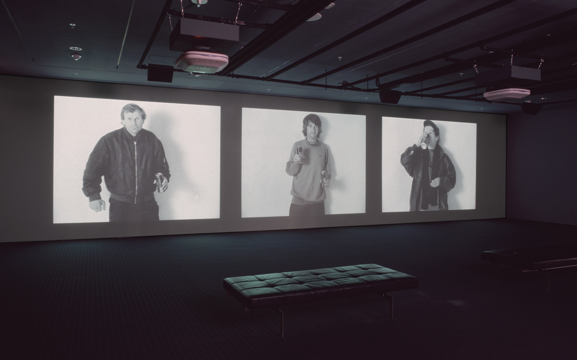 Gillian Wearing. *Drunk.* 1997–1999. Three-channel video (black and white, sound), 28:35 min. Dimensions variable; approximately 13′ × 37′ × 22' (396.2 × 1127.8 × 670.6 cm). Gift of Nina and Gordon Bunshaft, The Ken and Judith Joy Family Foundation, Barbara Foshay, and Margot P. Ernst. © 2016 Gillian Wearing