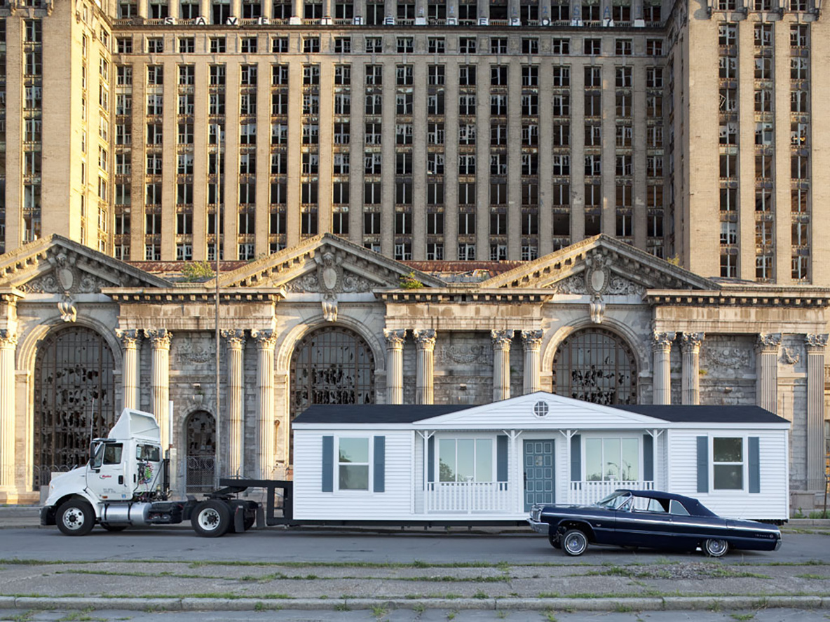 Mike Kelley. *The Mobile Homestead in front of the abandoned Detroit Central Train Station*. 2010. © Mike Kelley Estate, courtesy Mike Kelley Foundation for the Arts. Photograph by Corine Vermuelen