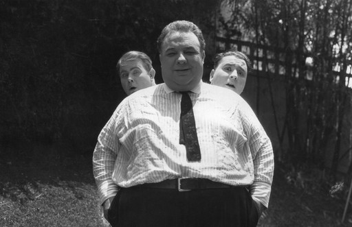 "Publicity shot of A Ton of Fun. Frank ""Fatty"" Alexander front, Hilliard ""Fatt"" Karr back, left, and Bill ""Kewpie"" Ross back right"