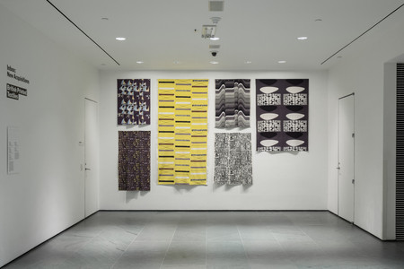 Installation view of Inbox: British Printed Textiles. From top to bottom, left to right: Marian Mahler (British, 1911–1983). Untitled. 1952–53. Screenprinted rayon, 40 1/2 × 45 1/2″ (102.9 × 115.6 cm). Manufacturer: David Whitehead Ltd. Gift of Jill A. Wiltse and H. Kirk Brown III, 2015. Lucienne Day (British, 1917–2010). Magnetic (Furnishing fabric). 1957. Roller-printed cotton, 54 × 49 1/2″ (137.2 × 125.7 cm). Manufacturer: Heal Fabrics. Lucienne Day. Mezzanine. 1958. Screenprinted cotton crepe, 95 1/2 × 48 1/4″ (242.6 × 122.6 cm). Gift of Jill A. Wiltse and H. Kirk Brown III, 2015. Barbara Brown (British, born 1932). Frequency (Furnishing fabric). 1969. Screenprinted cotton, 49 1/2 × 44 1/2″ (125.7 × 113 cm). Manufacturer: Heal Fabrics. Jill A. Wiltse and H. Kirk Brown III Collection, Gift of the Committee on Architecture & Design, 2015. Eduardo Paolozzi (British, 1924–2005). Bark Cloth. c. 1954. Screenprinted cotton, 45 1/2 × 50 1/4″ (115.6 × 127.6 cm). Manufacturer: Hammer Prints Ltd. Gift of Jill A. Wiltse and H. Kirk Brown III, 2015. Victor Vasarely (French, born Hungary. 1908–1997). Kernos (Furnishing fabric). 1962. Screenprinted cotton, 70 × 47 3/4″ (177.8 × 121.3 cm). Manufacturer: Edinburgh Weavers. Gift of Jill A. Wiltse and H. Kirk Brown III, 2015. Photo: John Wronn