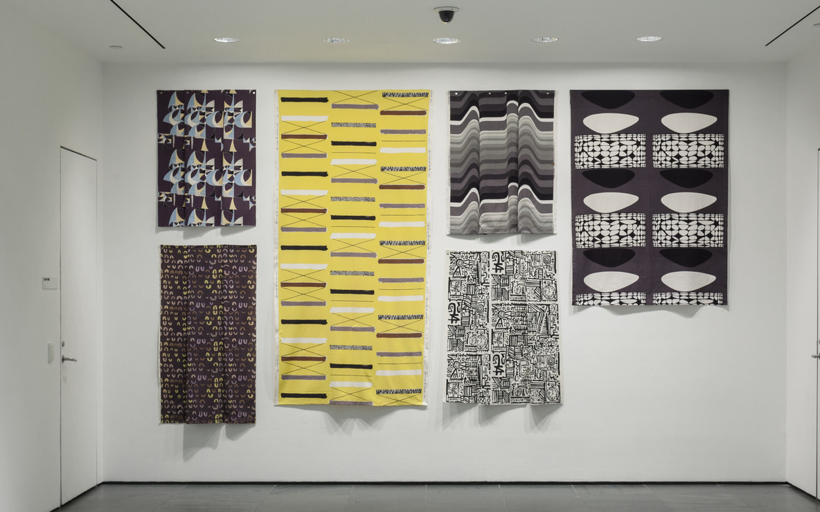 Installation view of *Inbox: British Printed Textiles.* From top to bottom, left to right: Marian Mahler (British, 1911–1983). Untitled. 1952–53. Screenprinted rayon, 40 1/2 × 45 1/2″ (102.9 × 115.6 cm). Manufacturer: David Whitehead Ltd. Gift of Jill A. Wiltse and H. Kirk Brown III, 2015.  Lucienne Day (British, 1917–2010). Magnetic (Furnishing fabric). 1957. Roller-printed cotton, 54 × 49 1/2″ (137.2 × 125.7 cm). Manufacturer: Heal Fabrics. Lucienne Day. Mezzanine. 1958. Screenprinted cotton crepe, 95 1/2 × 48 1/4″ (242.6 × 122.6 cm). Gift of Jill A. Wiltse and H. Kirk Brown III, 2015. Barbara Brown (British, born 1932). Frequency (Furnishing fabric). 1969. Screenprinted cotton, 49 1/2 × 44 1/2″ (125.7 × 113 cm). Manufacturer: Heal Fabrics. Jill A. Wiltse and H. Kirk Brown III Collection, Gift of the Committee on Architecture & Design, 2015. Eduardo Paolozzi (British, 1924–2005). Bark Cloth. c. 1954. Screenprinted cotton, 45 1/2 × 50 1/4″ (115.6 × 127.6 cm). Manufacturer: Hammer Prints Ltd. Gift of Jill A. Wiltse and H. Kirk Brown III, 2015. Victor Vasarely (French, born Hungary. 1908–1997). Kernos (Furnishing fabric). 1962. Screenprinted cotton, 70 × 47 3/4″ (177.8 × 121.3 cm). Manufacturer: Edinburgh Weavers. Gift of Jill A. Wiltse and H. Kirk Brown III, 2015. Photo: John Wronn
