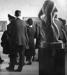 Unidentified visitors at the exhibition Americans 1942: 18 Artists from 9 States. Photographic Archive. The Museum of Modern Art Archives, New York. Photo: Albert Fenn