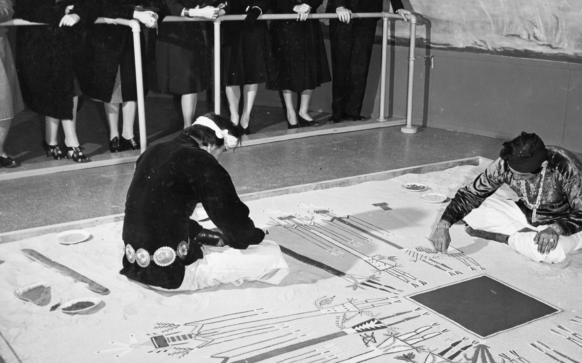 Navajo Indians sand painting, March 26, 1941, at the exhibition *Indian Art of the United States.* Photographic Archive. The Museum of Modern Art Archives, New York. Photo: Eliot Elisofon