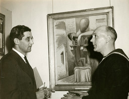 James Thrall Soby, Director of the Armed Services Program of the Museum of Modern Art, shown with an English sailor at the Service Party which inaugurated the Art Sale for Armed Services (May 6–June 16, 1942). Picture for sale on the wall is by Giorgio de Chirico. Photographic Archive. The Museum of Modern Art Archives, New York. Photo: Albert Fenn