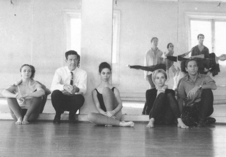 Rehearsal at Merce Cunningham's studio, 1964. Left to right, seated: Barbara Dilley Lloyd, John Cage, Sandra Neels, Shareen Blair, and Robert Rauschenberg. Left to right, standing: MC, Carolyn Brown, Steve Paxton, William David, and Viola Farber. Photo: Robert Rauschenberg © Robert Rauschenberg Foundation