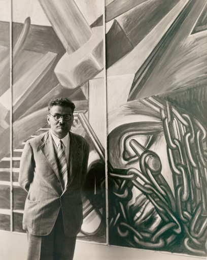 "José Clemente Orozco with his fresco ""Dive Bomber and Tank,"" commissioned by MoMA during the exhibition ""Twenty Centuries of Mexican Art,"" May 15–September 30, 1940. Photographic Archive. The Museum of Modern Art Archives, New York"
