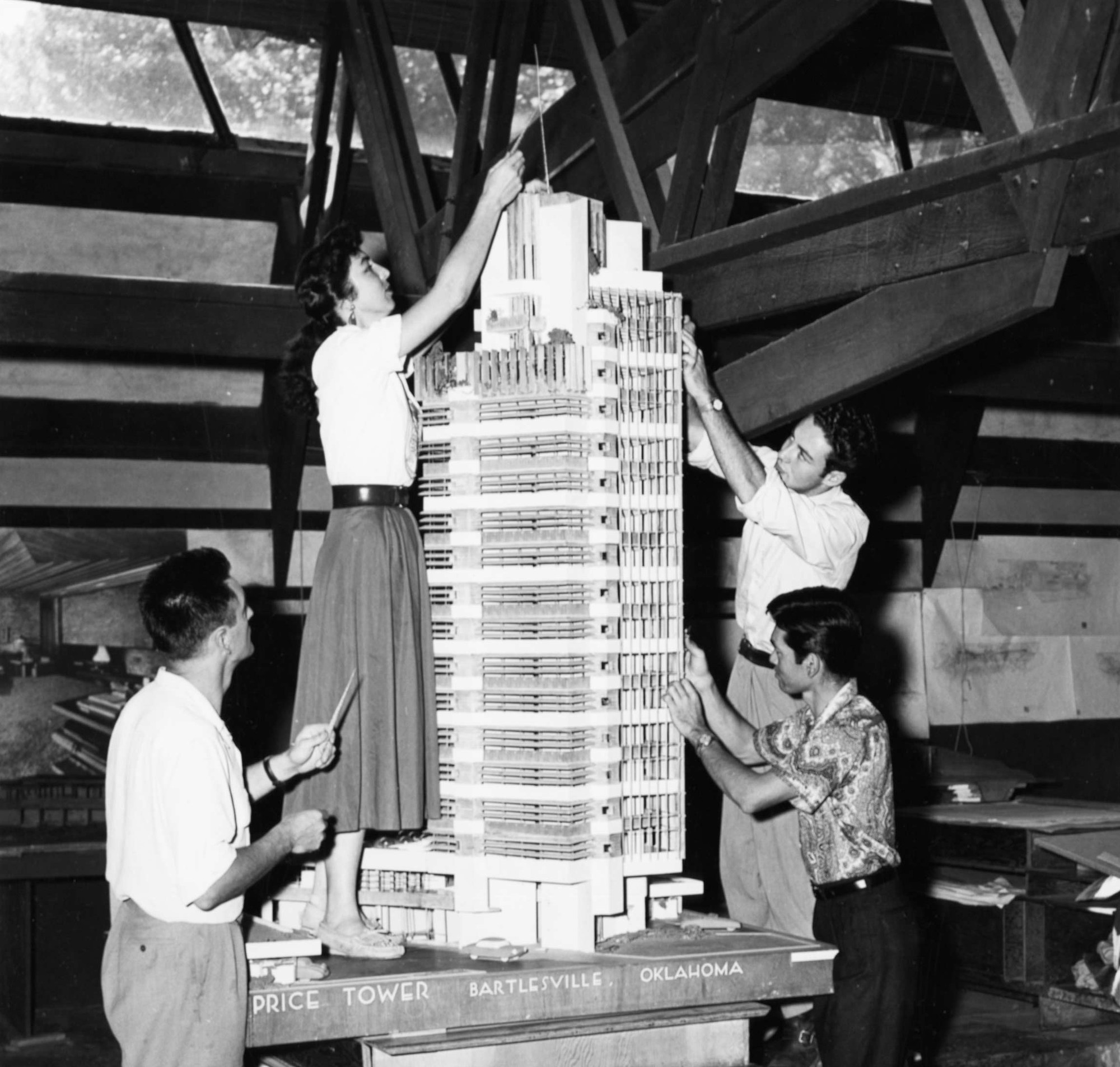 Frank Lloyd Wright. H. C. Price Company Tower, Bartlesville, OK. 1952–56. Apprentices working on the model in the Taliesin drafting room, Spring Green, Winsconsin, c. 1952. The Frank Lloyd Wright Foundation Archives (The Museum of Modern Art | Avery Architectural & Fine Arts Library, Columbia University, New York)