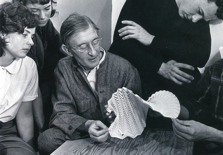 Josef Albers examining a folded paper construction with students at Black Mountain College, 1946. Photo: Genevieve Naylor