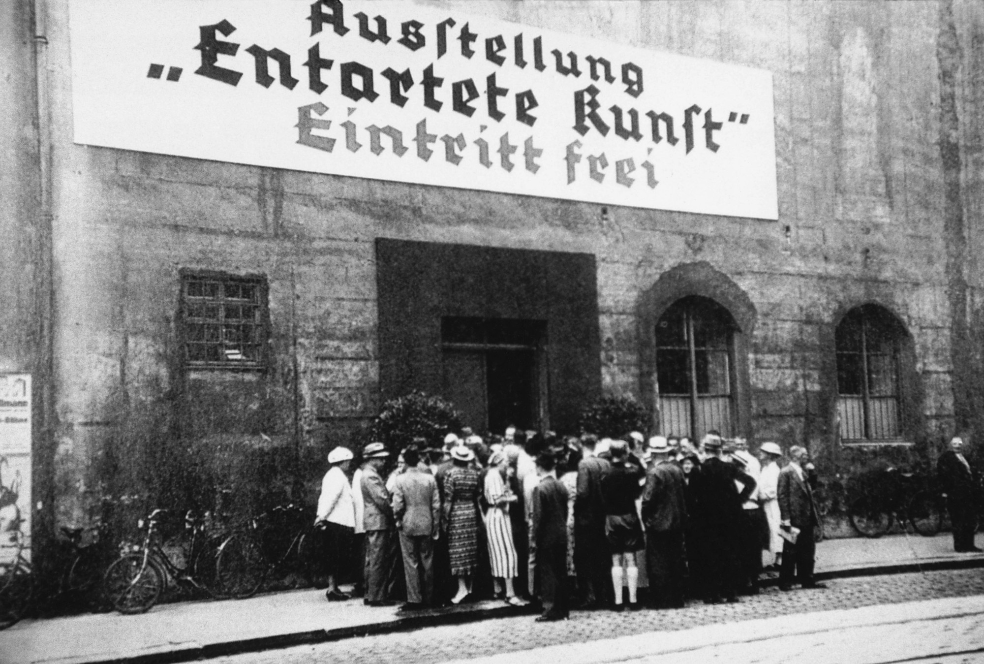 People queueing for the Degenerate Art (Entartete Kunst) exhibition in Munich, which opened on July 19, 1937. © The Image Works