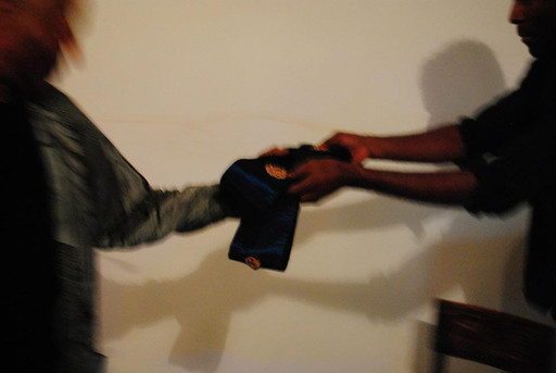 Terry Adkins and Kamau Amu Patton exchange a Lone Wolf Recital Corps sash at Third Streaming, New York, 2013
