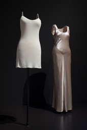Calvin Klein (American, born 1942). Calvin Klein (United States, founded 1968). Dress, 1994. Silk matte jersey. Dress, 1995. Hammered silk satin. PVH Corp./Calvin Klein Inc. Archives. Image taken during installation of Items: Is Fashion Modern?