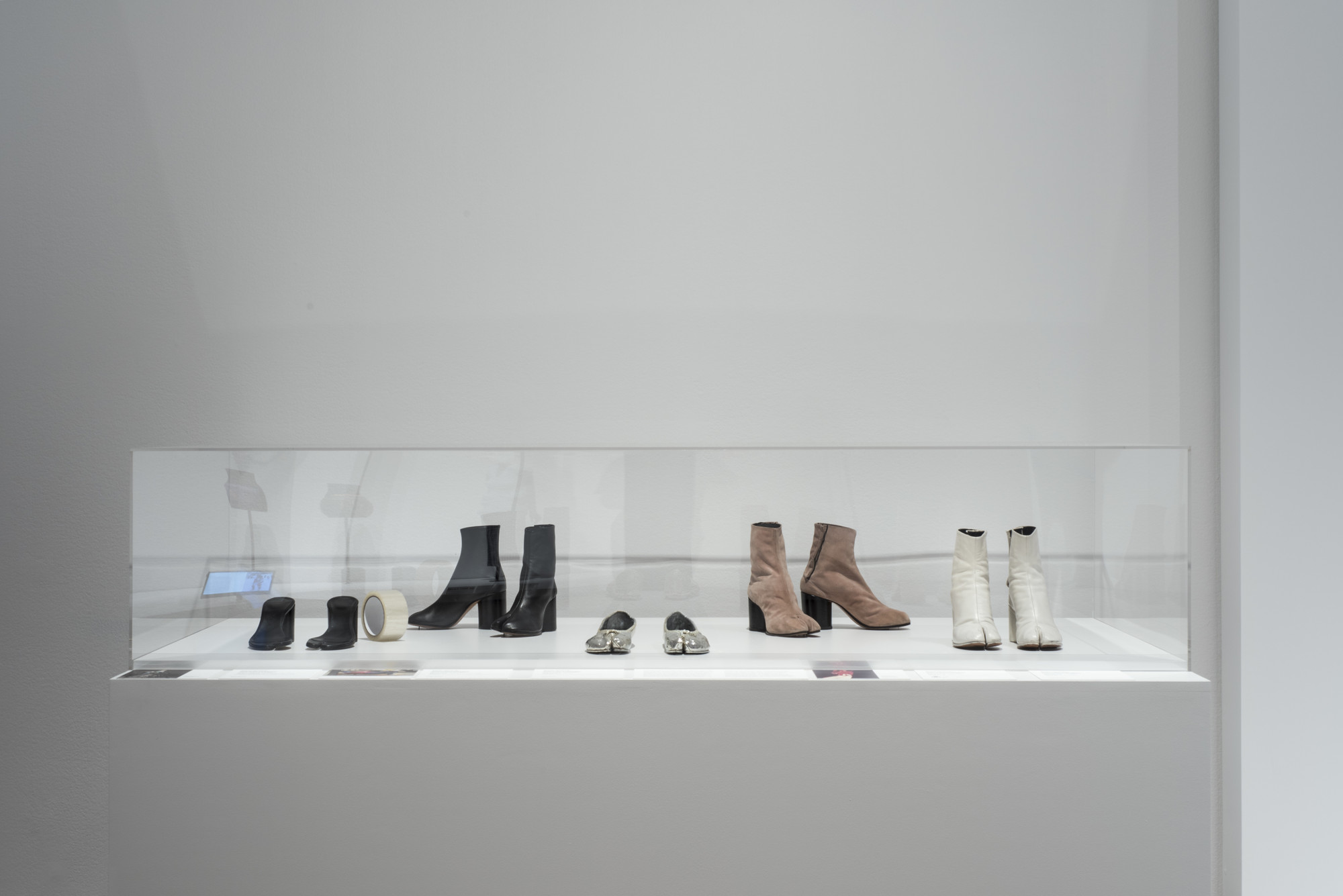 Martin Margiela (Belgian, born 1957). Maison Martin Margiela (later Maison Margiela) (France, founded 1988). Boots. 1990–99. Leather. Sandals. Spring/summer 1996. Leather and adhesive tape. Boots. Spring/summer 1989. Suede. Shoes. 2008. Leather. Fashion Museum, Province of Antwerp. Boots. c. 1990. Leather. Lent by Linda Loppa. Image taken during installation of _Items: Is Fashion Modern?_