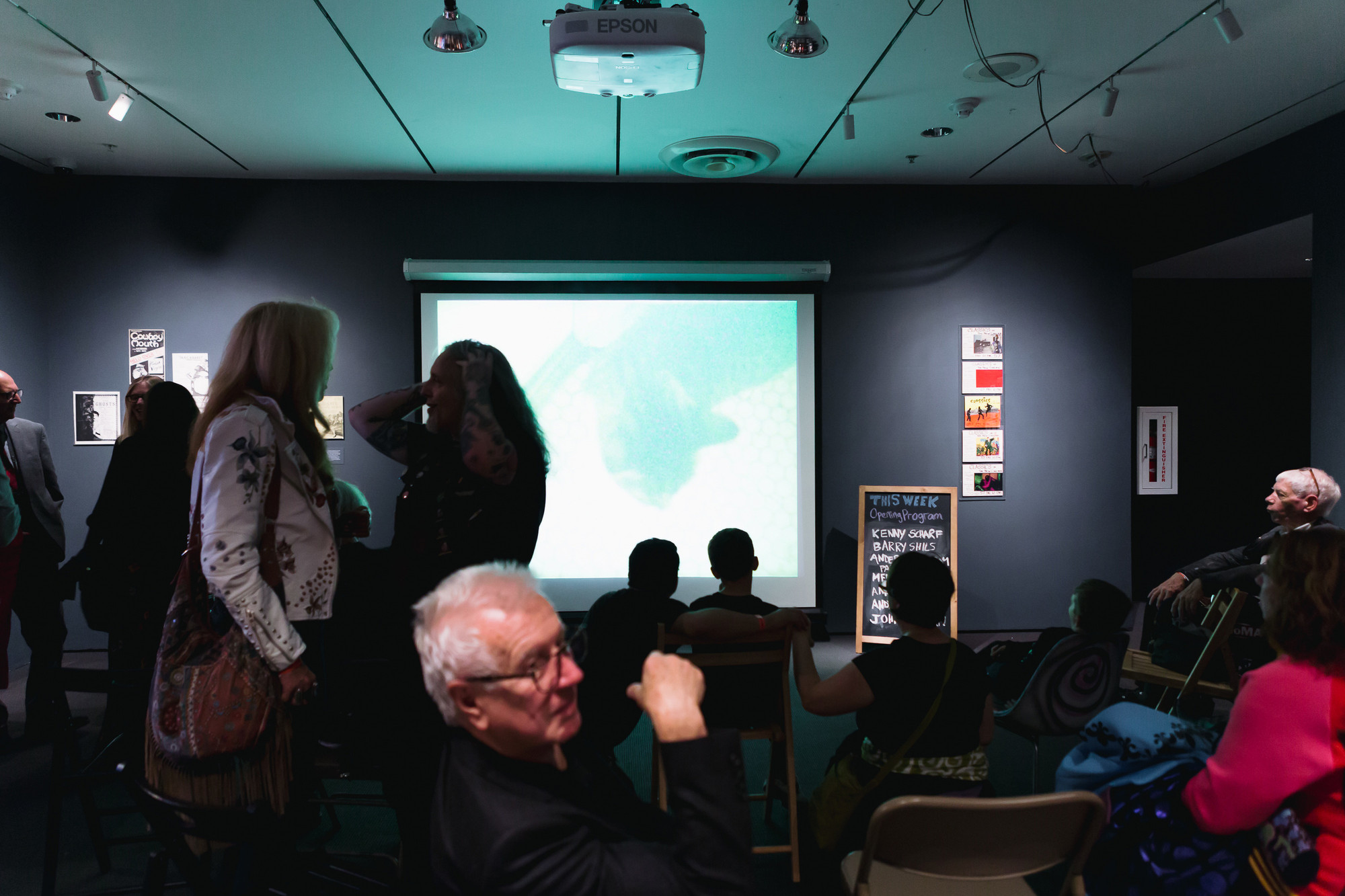 Visitors in the Titus 1 Theater Gallery during the Club 57 exhibition opening. Photo: Josefina Santos