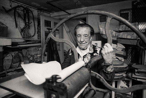 Louise Bourgeois at the printing press in the lower level of her home/studio on 20th Street, New York, 1995. Photograph: Mathias Johansson