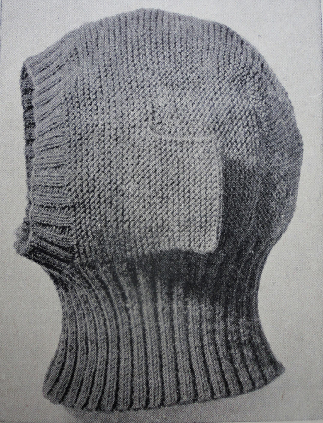 A knitted balaclava helmet with adjustable earflaps, worn during the Crimean War and reappropriated during world wars I and II, 1941. Public domain image